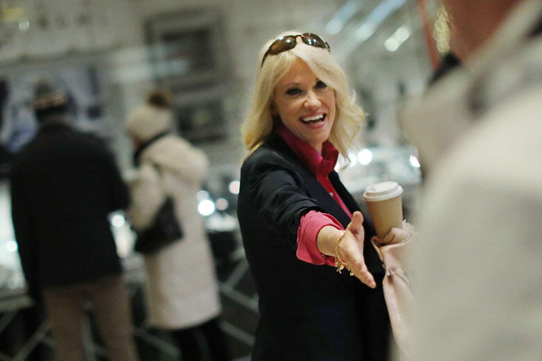 NEW YORK, NY - DECEMBER 16:  Kellyanne Conway greets a supporter as she walks through Trump Tower on December 16, 2016 in New York City. President-Elect Donald Trump continues to hold meetings with potential members of his cabinet and others at his midtow
