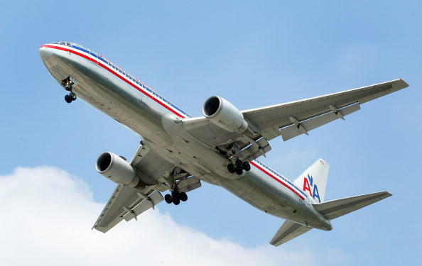 ROSEMONT, IL - SEPTEMBER 3:  An American Airlines jet is seen in the air preparing to land September 3, 2004 at Chicago's O'Hare International Airport in Rosemont, Illinois. American Airlines announced December 10, 2004 that they will be raising domestic