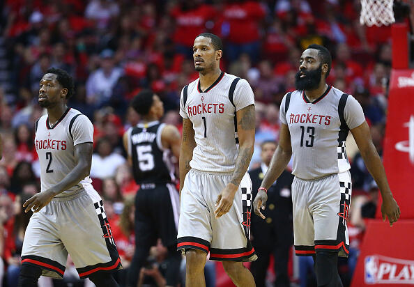 HOUSTON, TX - MAY 11:  Patrick Beverley #2, Trevor Ariza #1 and James Harden #13 of the Houston Rockets reacts against the San Antonio Spurs during Game Six of the NBA Western Conference Semi-Finals at Toyota Center on May 11, 2017 in Houston, Texas.  NOTE TO USER: User expressly acknowledges and agrees that, by downloading and or using this photograph, User is consenting to the terms and conditions of the Getty Images License Agreement.  (Photo by Ronald Martinez/Getty Images)