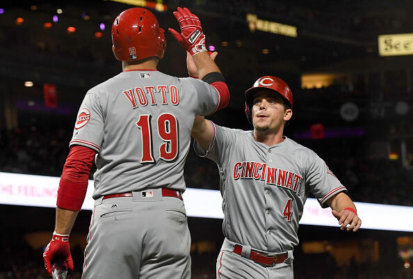 SAN FRANCISCO, CA - MAY 11:  Scooter Gennett #4 of the Cincinnati Reds is congratulated by Joey Votto #19 after Gennett scored against the San Francisco Giants in the top of the eighth inning at AT&T Park on May 11, 2017 in San Francisco, California.  (Photo by Thearon W. Henderson/Getty Images)