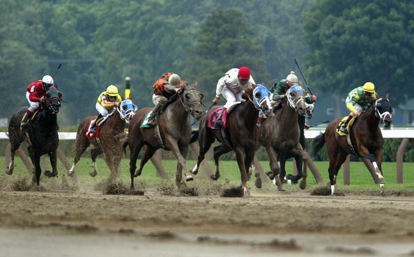 SARATOGA SPRINGS, NEW YORK - JULY 27:  Thoroughbreds race at Saratoga Race Course during opening weekend of the thoroughbred racing season July 27, 2003 in Saratoga Springs, New York. The horse racing industry is hoping that the release of the new movie
