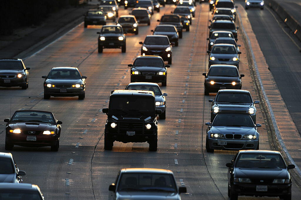 People drive on Highway 134 (Ventura Freeway) at the end of the evening rush hour in Glendale, California on September 3, 2010, before the start of the three-day Labor Day holiday weekend. Close to 34.4 million people will travel at least 50 miles from ho