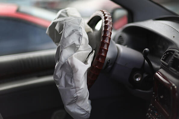 MEDLEY, FL - MAY 22:  A deployed airbag is seen in a Chrysler vehicle at the LKQ Pick Your Part salvage yard on May 22, 2015 in Medley, Florida. The largest automotive recall in history centers around the defective Takata Corp. air bags that are found in millions of vehicles that are manufactured by BMW, Chrysler, Daimler Trucks, Ford, General Motors, Honda, Mazda, Mitsubishi, Nissan, Subaru and Toyota.  (Photo by Joe Raedle/Getty Images)