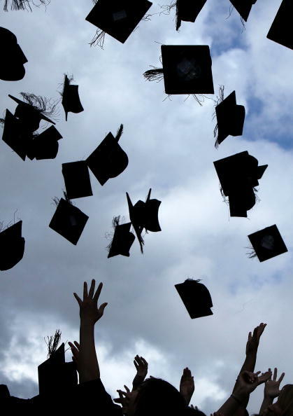 BIRMINGHAM, ENGLAND - JULY 14:  Students throw their mortarboards in the air during their graduation photograph at the University of Birmingham degree congregations  on July 14, 2009 in Birmingham, England. Over 5000 graduates will be donning their robes