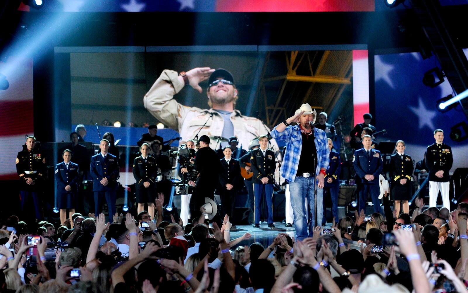 LAS VEGAS, NV - APRIL 07:  Recording artist Toby Keith performs onstage during ACM Presents: An All-Star Salute To The Troops at the MGM Grand Garden Arena on April 7, 2014 in Las Vegas, Nevada.  (Photo by Ethan Miller/Getty Images for ACM)