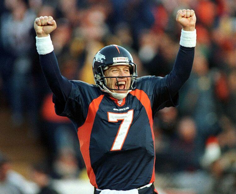 Denver Broncos quarterback John Elway celebrates a