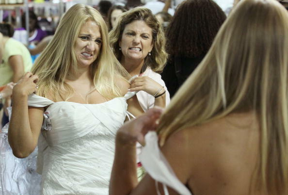 BETHESDA, MD - JULY 30:  Bride to be Lauren Cechak (L) and her mother Elaine Cechak express their dislike for a wedding gown during Filene's Basement's annual sale July 30, 2010 in Bethesda, Maryland. Hundreds of brides to be and their shopping teams line