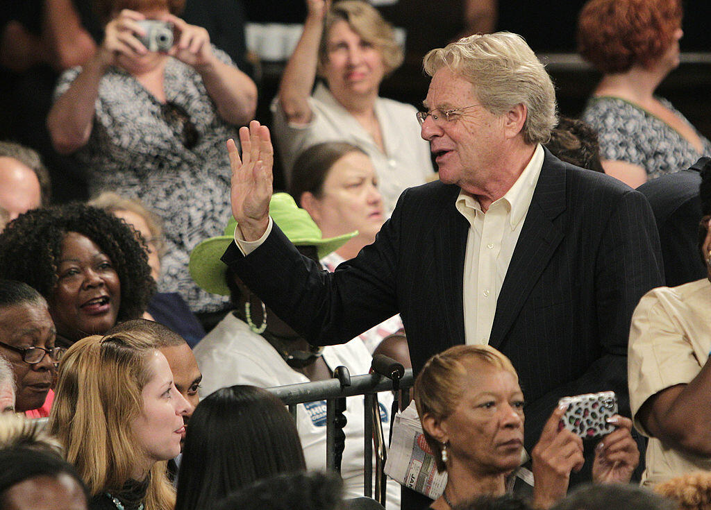 CINCINNATI, OH - JULY 16:  Former Cincinnati mayor and talk show host Jerry Springer waves to people in the crowd as he sits down before the start of a campaign event where U.S. President Barack Obama spoke about the economy July 16, 2012 in Cincinnati, O