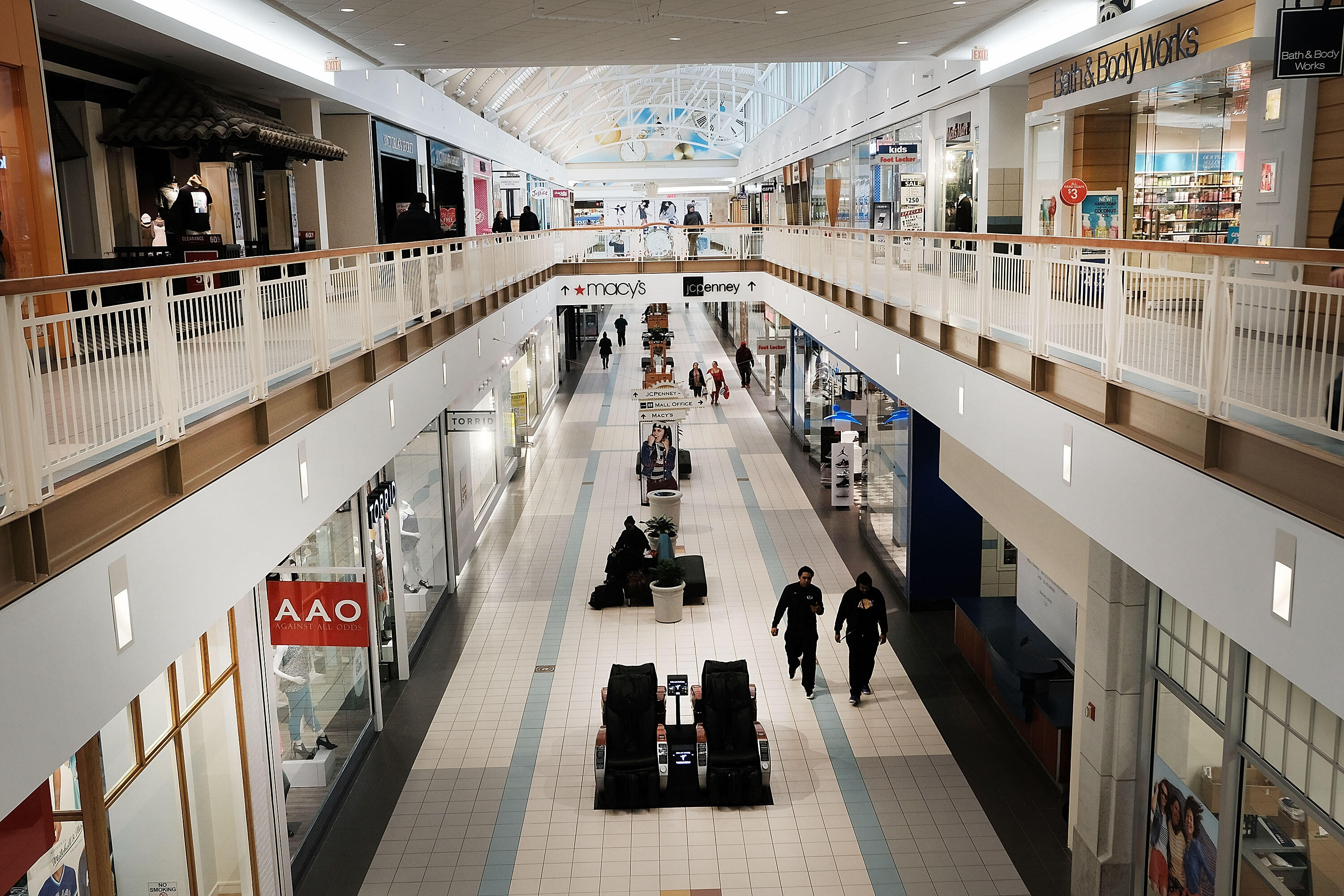 WATERBURY, CT - MARCH 28: People walk through a nearly empty shopping mall on March 28, 2017 in Waterbury, Connecticut. As consumers buying habits change and more people prefer to spend money on technology and experiences like vacations over apparel, shop