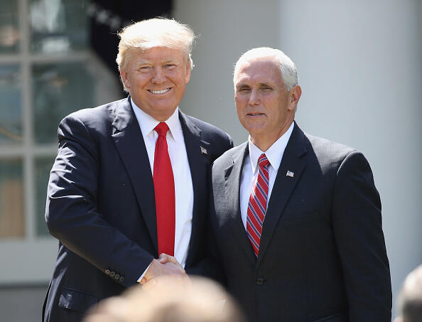 WASHINGTON, DC - JUNE 01:  U.S. President Donald Trump shakes hands with Vice President Mike Pence prior to announcing his decision regarding the United States' participation in the Paris climate agreement in the Rose Garden at the White House June 1, 2017 in Washington, DC. Trump pledged on the campaign trail to withdraw from the accord, which former President Barack Obama and the leaders of 194 other countries signed in 2015. The agreement is intended to encourage the reduction of greenhouse gas emissions in an effort to limit global warming to a manageable level.  (Photo by Win McNamee/Getty Images)
