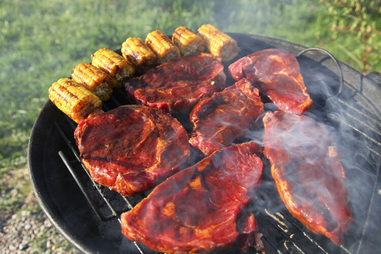 Barbeque meat and corn on a grill