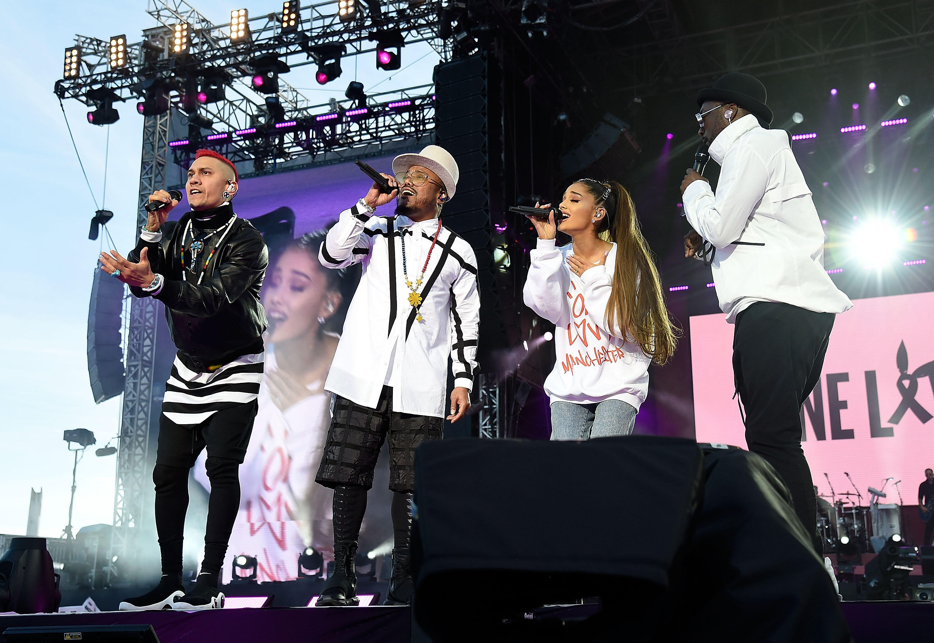 MANCHESTER, ENGLAND - JUNE 04:  Ariana Grande performs on stage with Taboo (L) apl.de.ap (2nd L) and will.i.am (R) of The Black Eyed Peas during the One Love Manchester Benefit Concert at Old Trafford on June 4, 2017 in Manchester, England.  (Photo by Kev