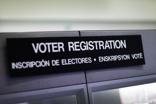 MIAMI, FL - OCTOBER 01:  A voter registration sign hangs at the Miami-Dade Election Department on October 1, 2012 in Miami, Florida. With the October ninth deadline for people to register to vote in the upcoming election approaching, the Florida Departmen