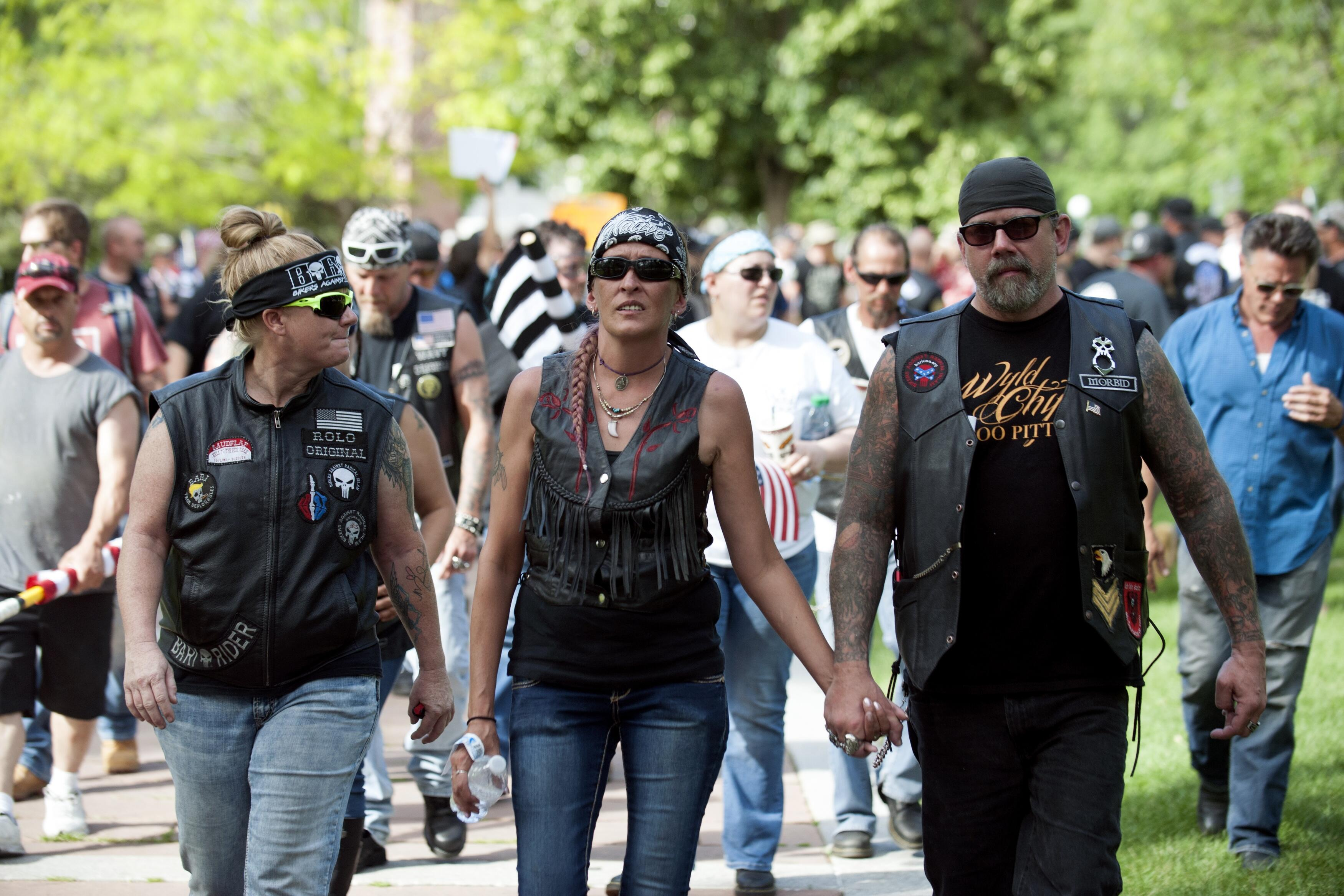 Members of Bikers Against Radical Islam leave the Denver March Against Sharia Law in Denver, Colorado on June 10, 2017. The march was supported by two right-wing groups, The Proud Boys, and Bikers Against Radical Islam. Police kept the counter protestors