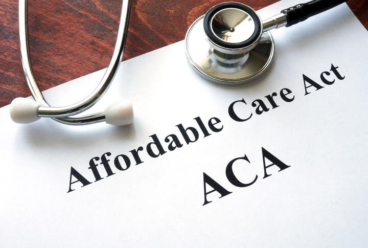 Words Affordable Care Act  ACA written on a paper.