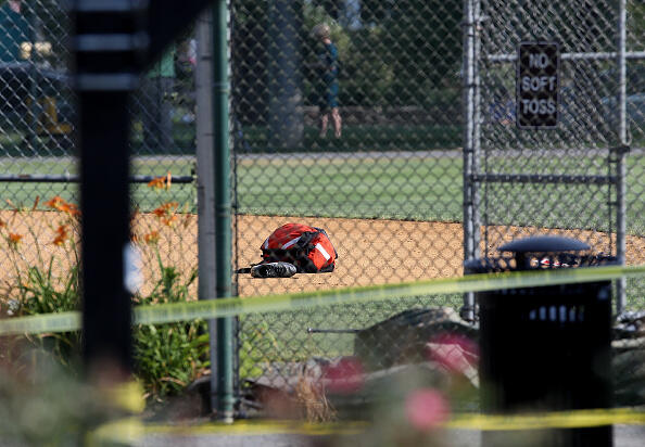 ALEXANDRIA, VA - JUNE 14:  Baseball equipment lays on the infielf at Eugene Simpson Field, the site where a gunman opened fire June 14, 2017 in Alexandria, Virginia. Multiple injuries were reported from the instance, the site where a congressional baseball team was holding an early morning practice, including House Republican Whip Steve Scalise (R-LA) who was reportedly shot in the hip.   (Photo by Win McNamee/Getty Images)