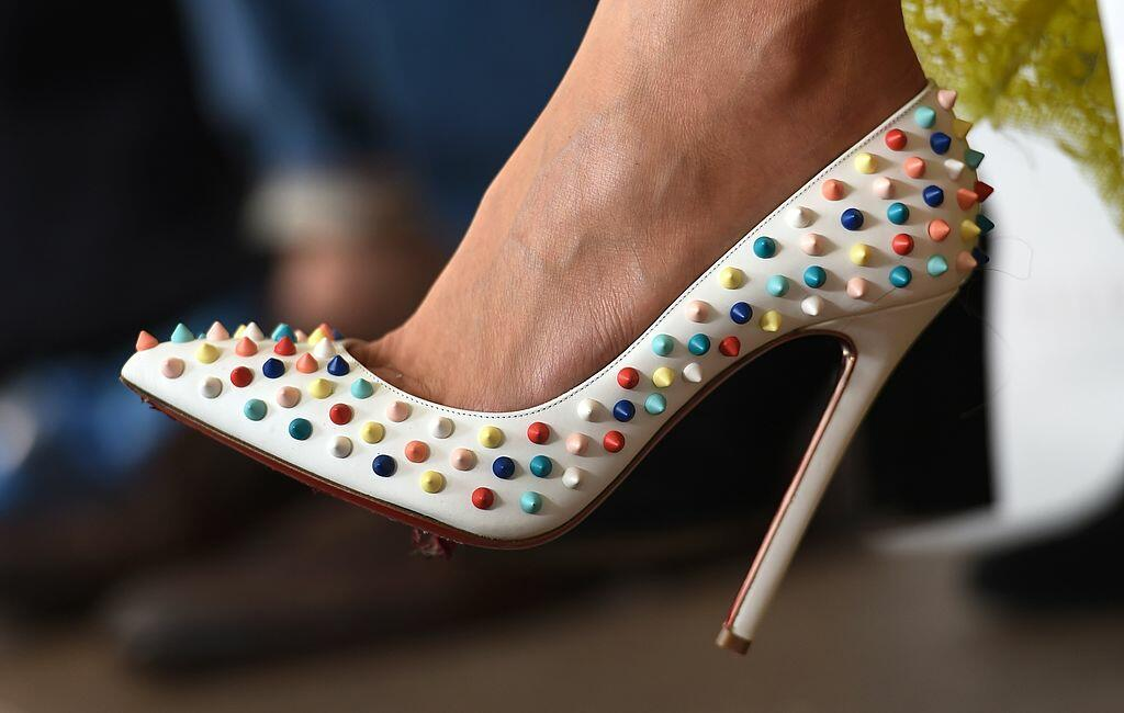 A fashionista wears colourful shoes during a parade by Australian designer Kym Ellery in the showing of her label Ellery at Fashion Week Australia, in Sydney on April 7, 2014.  The four-day schedule will include a curated selection of Australias establish