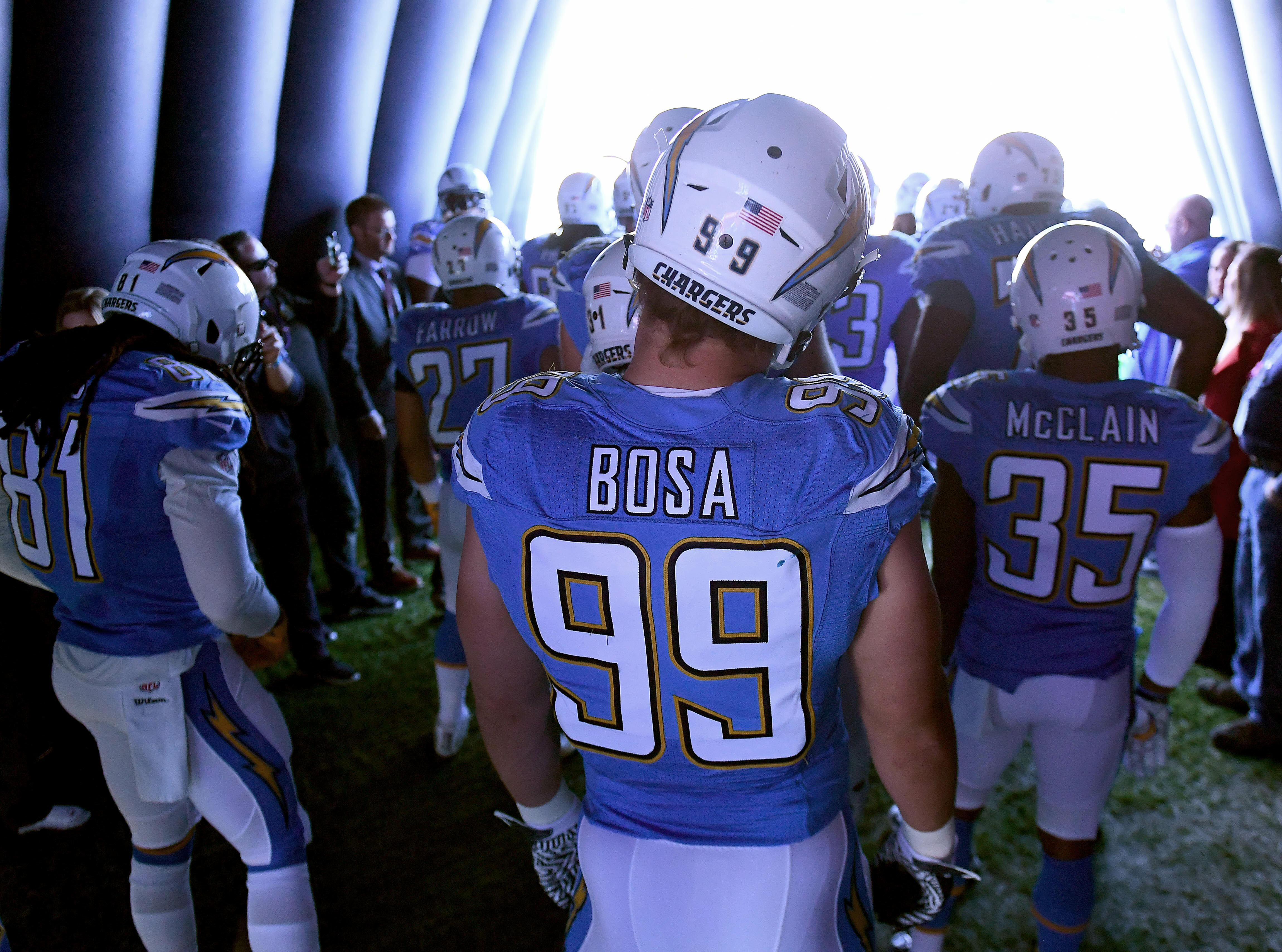 SAN DIEGO, CA - DECEMBER 18: Joey Bosa #99 of the San Diego Chargers prepares to enter the field against the Oakland Raiders at Qualcomm Stadium on December 18, 2016 in San Diego, California. (Photo by Donald Miralle/Getty Images)