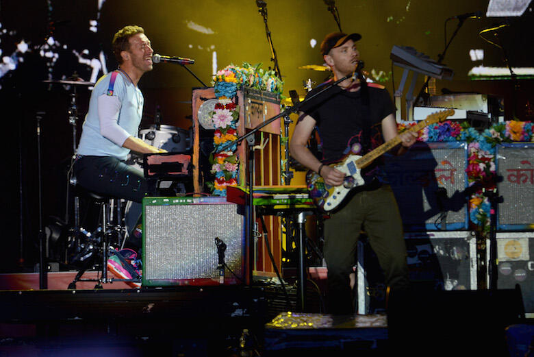 MANCHESTER, ENGLAND - JUNE 04:  NO SALES, free for editorial use. In this handout provided by 'One Love Manchester' benefit concert (L) Chris Martin and Jonny Buckland of Coldplay perform on stage on June 4, 2017 in Manchester, England. Donate at www.redc