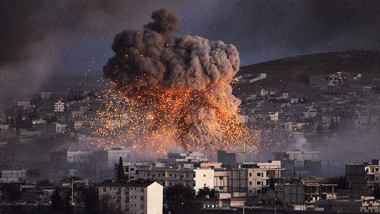 SANLIURFA, TURKEY -  OCTOBER 20:  (TURKEY OUT)   An explosion rocks Syrian city of Kobani during a reported suicide car bomb attack by the militants of Islamic State (ISIS) group on a People's Protection Unit (YPG) position in the city center of Kobani, a