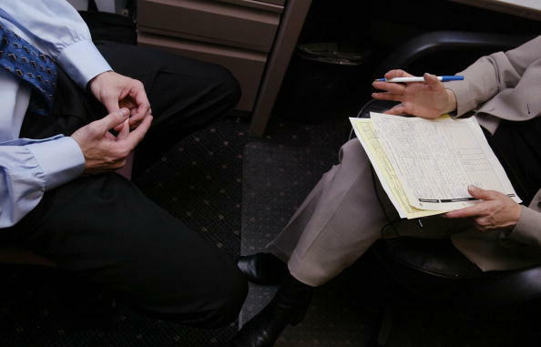 NEW YORK - MAY 7:  A job applicant (L) speaks with recruiter Renee Chandler (R) during an interview May 7, 2003 at the offices of Metro Support Group in New York City.  The nation's jobless rate climbed to six percent in April, rising for the third straig