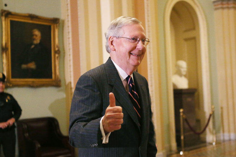 WASHINGTON, DC - FEBRUARY 07:  Senate Majority Leader Mitch McConnell (R-KY) gives the thumbs-up to the media after the Senate voted to confirm Betsy DeVos as education secretary on Capitol Hill on February 7, 2017 in Washington, D.C. The historic 51-50 v