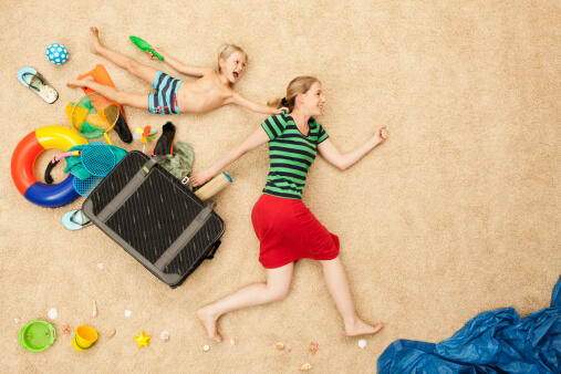 Germany, Mother and son with toys and baggage at beach