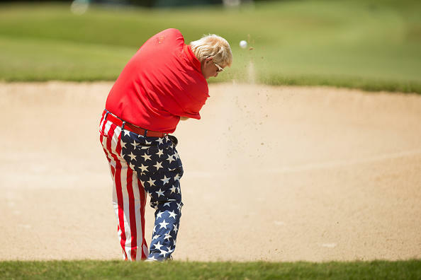 THE WOODLANDS, TX - MAY 07: John Daly of the United States plays his second shot from a bunker at the 11th hole during the third round of the PGA TOUR Champions Insperity Invitational at The Woodlands Country Club on May 7, 2017 in The Woodlands, Texas. (Photo by Darren Carroll/Getty Images)