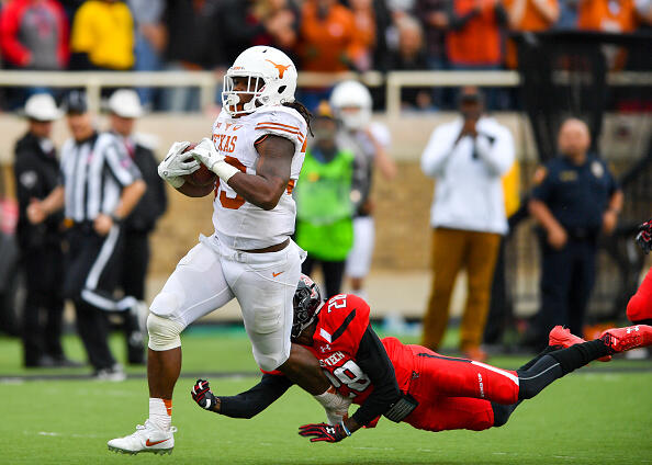 LUBBOCK, TX - NOVEMBER 05: D'Onta Foreman #33 of the Texas Longhorns breaks the tackle of Paul Banks III #28 of the Texas Tech Red Raiders during the game on November 5, 2016 at AT&T Jones Stadium in Lubbock, Texas. Texas defeated Texas Tech 45-37. (Photo by John Weast/Getty Images)