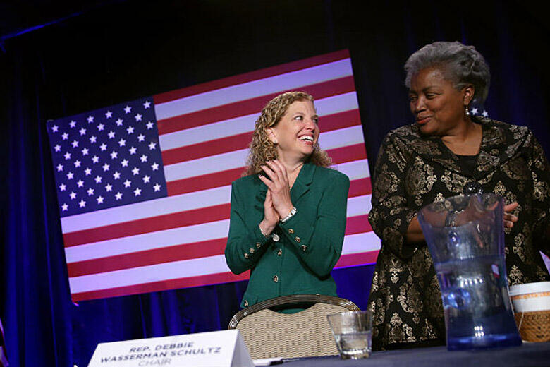 WASHINGTON, DC - FEBRUARY 20:  (AFP OUT)  U.S. President Barack Obama speaks (L) as Democratic National Committee Chair and Rep. Debbie Wasserman Schultz (D-FL) (2nd R) and Vice Chair for Voter Registration and Participation Donna Brazile (R) share a mome