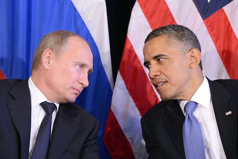 US President Barack Obama (R) listens to Russian President Vladimir Putin after their bilateral meeting in Los Cabos, Mexico on June 18, 2012 on the sidelines of the G20 summit. Obama and President Vladimir Putin met Monday, for the first time since the R