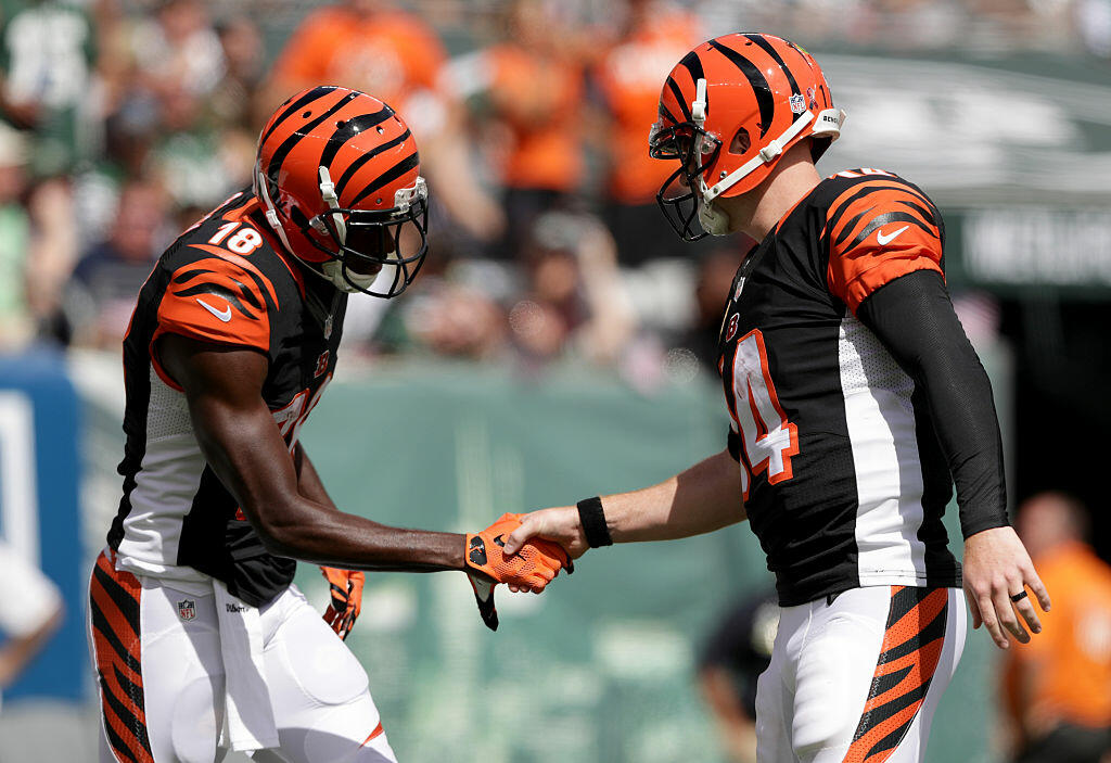 EAST RUTHERFORD, NJ - SEPTEMBER 11:  Temmates  Andy Dalton #14 of the Cincinnati Bengals and  A.J. Green #18 of the Cincinnati Bengals celebrate after scoring a touchdown against the New York Jets at MetLife Stadium on September 11, 2016 in East Rutherford, New Jersey.  (Photo by Streeter Lecka/Getty Images)