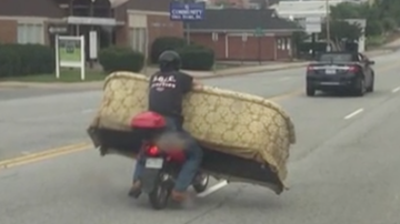 Chris Carmichael - WATCH: Man Has No Problem Moving Large Sofa With Scooter