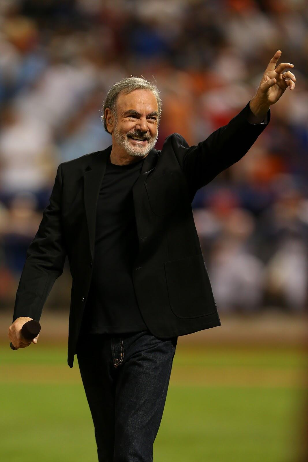 NEW YORK, NY - JULY 16:  Singer Neil Diamond performs during the 84th MLB All-Star Game on July 16, 2013 at Citi Field in the Flushing neighborhood of the Queens borough of New York City.  (Photo by Mike Ehrmann/Getty Images)