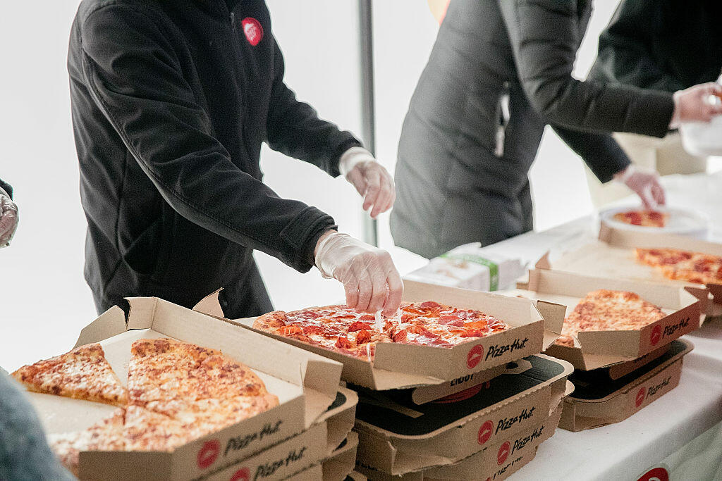 TERRE HAUTE, IN - NOVEMBER 19:  Cross country fans enjoy slices of Pizza Hut pizza at the Division I Cross Country Championship. Pizza Hut served more than 3,200 slices of pizza as the Official Pizza Partner of the NCAA on November 19, 2016 in Terre Haute, Indiana.  (Photo by Jeff Schear/Getty Images for Pizza Hut)
