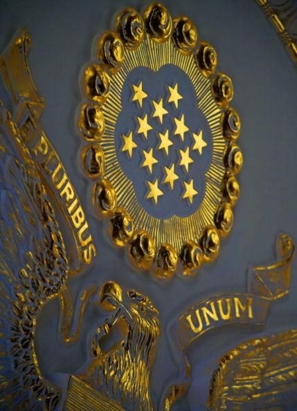 """The gilded """"E Pluribus Unum"""" symbol is s"""