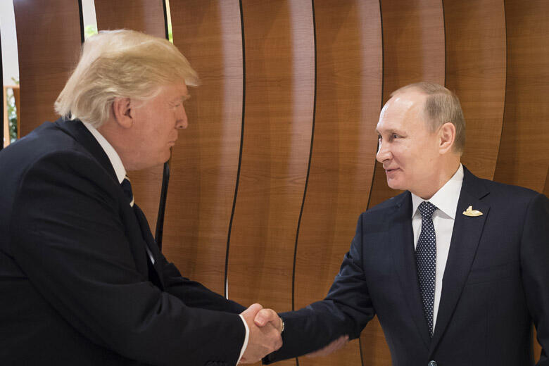 HAMBURG, GERMANY - JULY 07: In this photo provided by the German Government Press Office (BPA) Donald Trump, President of the USA (left), meets Vladimir Putin, President of Russia (right), at the opening of the G20 summit on July 7, 2017 in Hamburg, Germa
