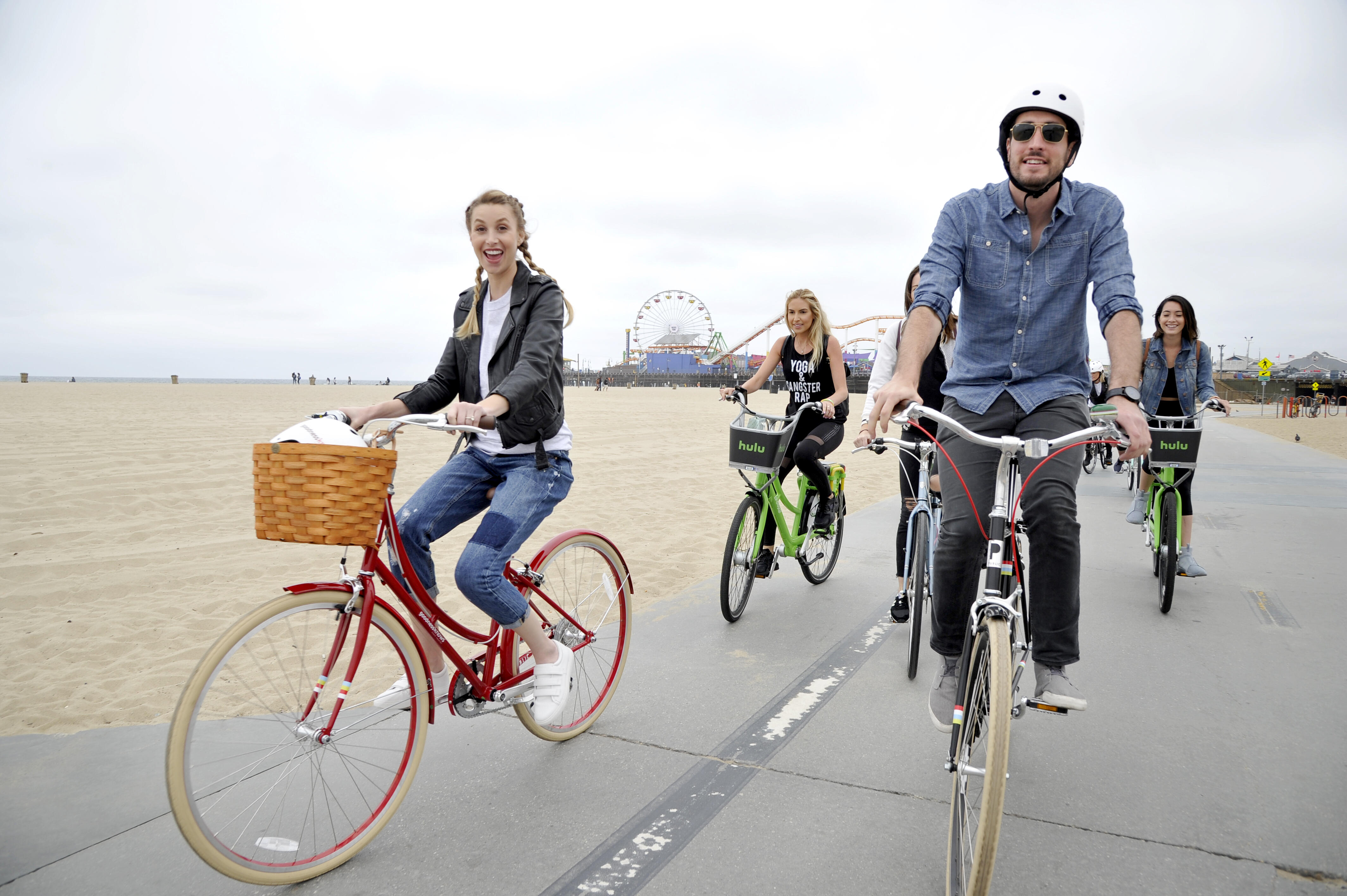 SANTA MONICA, CA - MAY 18:  Lifestyle expert and fashion designer Whitney Port and Shaun Boylan of Public Bikes lead a group bike ride with goodnessknows snack squares to celebrate national Bike to Work Week on May 18, 2016 in Santa Monica, California.  (