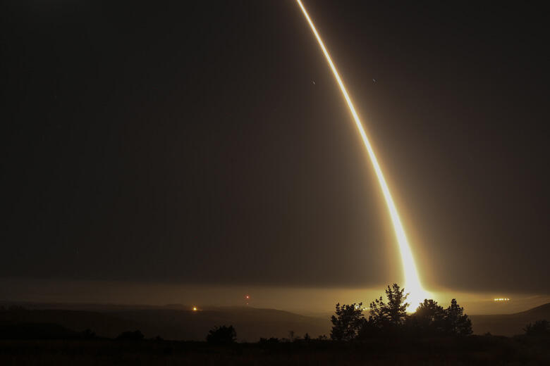 A streak of light trails off into the night sky as the US military test fires an unarmed intercontinental ballistic missile (ICBM) at Vandenberg Air Force Base, some 130 miles (209 kms) northwest of Los Angeles, California early on May 3, 2017. / AFP PHOT