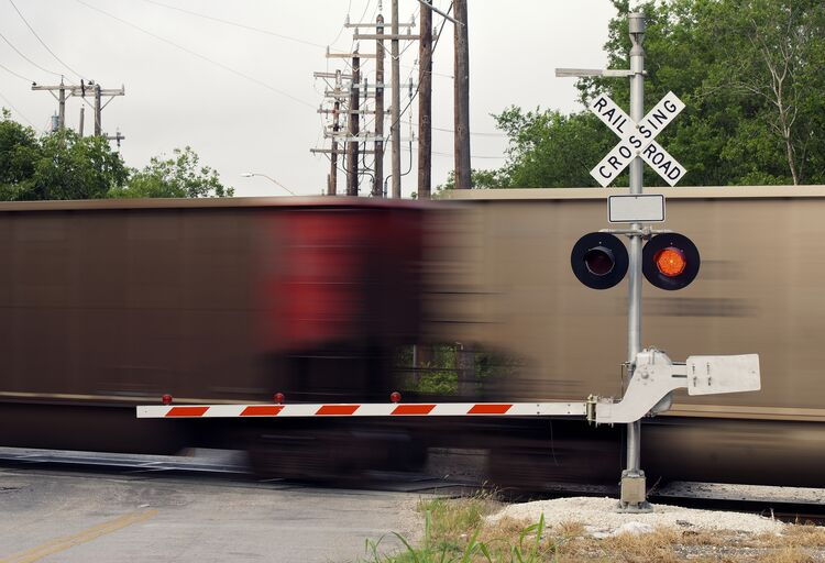 Moving Freight Train at Railroad Crossing