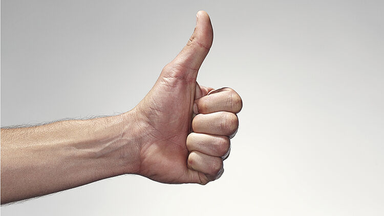 Hand giving the thumbs up