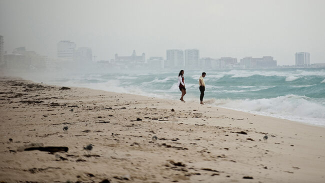 A couple walks in Playa del Carmen beach