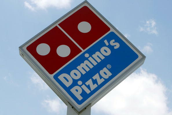 MIAMI, FL - APRIL 14: A sign in front of a  Domino's Pizza April 14, 2004 in Miami, Florida. Domino's Pizza is looking to raise $300 million in the stock market by listing on the New York Stock exchange. The Michigan-based firm already has a London stock