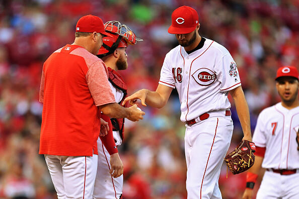 CINCINNATI, OH - JULY 14:  Pitcher Tim Adleman #46 of the Cincinnati Reds hands the ball to manager Bryan Price #38 of the Cincinnati Reds after being pulled in the fifth inning against the Washington Nationals at Great American Ball Park on July 14, 2017 in Cincinnati, Ohio. Washington shut out Cincinnati 5-0.  (Photo by Jamie Sabau/Getty Images)