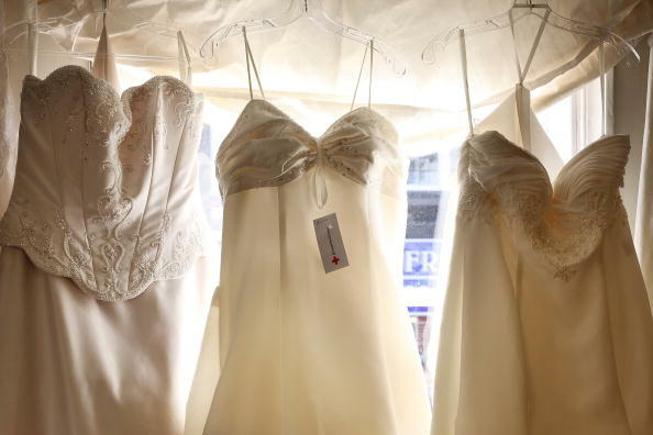 DORKING, ENGLAND - FEBRUARY 21: Second hand wedding dresses are displayed for sale at the Red Cross charity bridal shop on February 21, 2009 in Dorking, England. Sales of second bridal outfits and accesories have increased. The average wedding now costs �