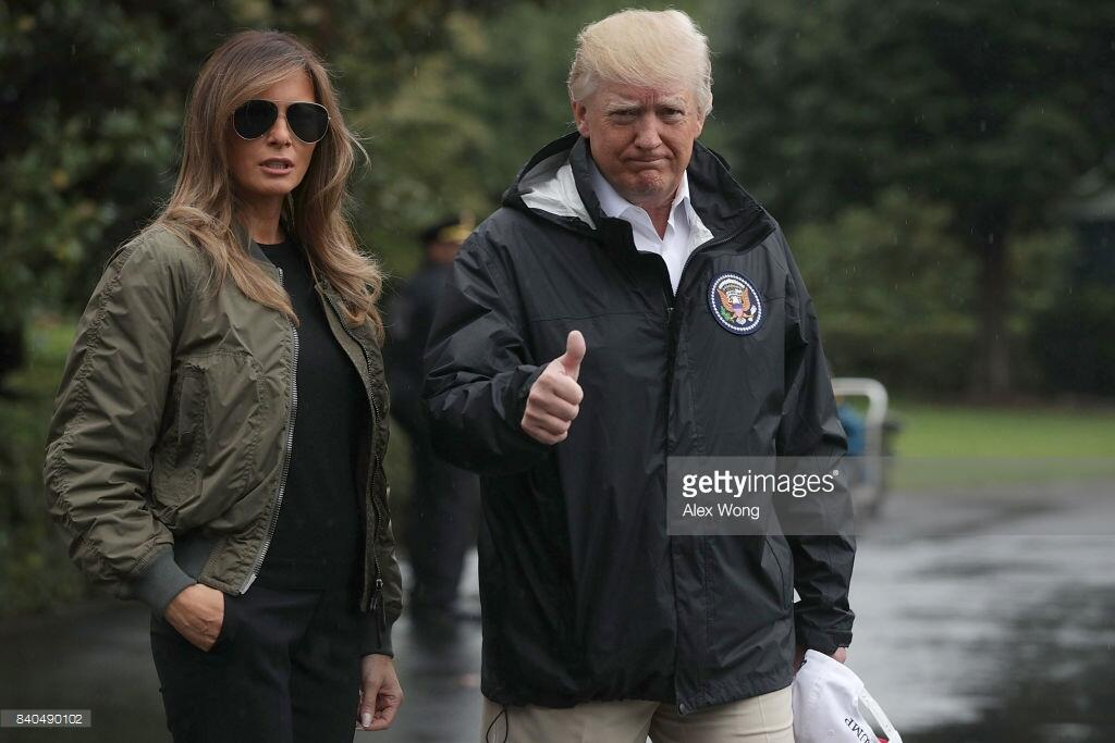 WASHINGTON, DC - AUGUST 29: U.S. President Donald Trump gives a thumbs up as he walks with first lady Melania Trump prior to their Marine One departure from the White House August 29, 2017, in Washington, DC. President Trump was traveling to Texas to observe the Hurricane Harvey relief efforts. (Photo by Alex Wong/Getty Images)
