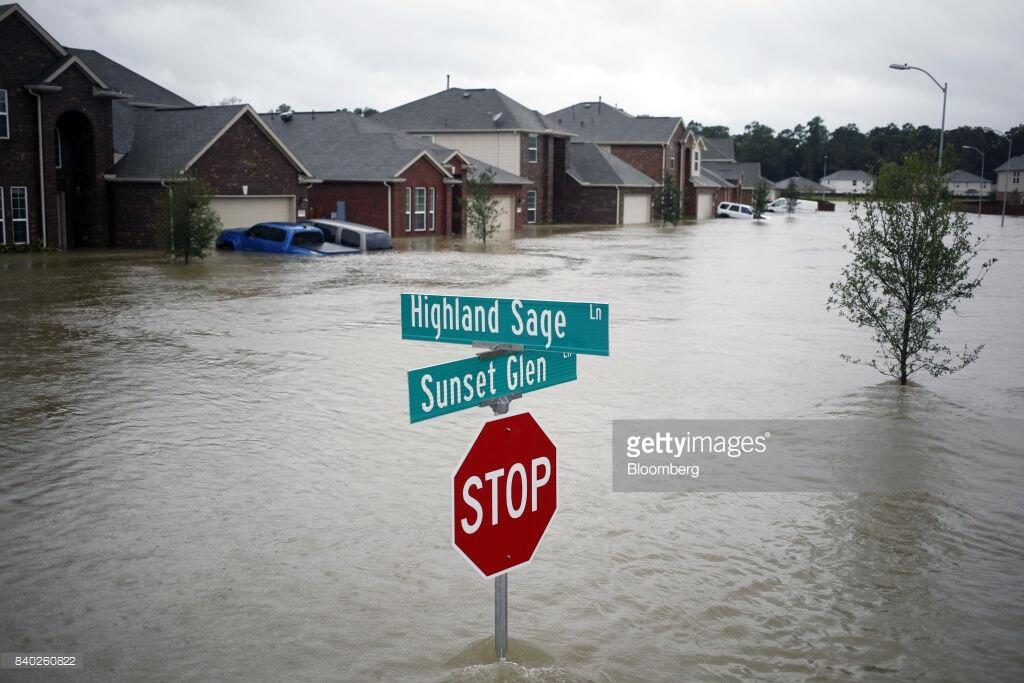 Houses at the Highland Glen subdivision stand in flood waters due to Hurricane Harvey in Spring, Texas, U.S., on Monday, Aug. 28, 2017. A deluge of rain and rising floodwaters left Houston immersed and helpless, crippling a global center of the oil industry and testing the economic resiliency of a state that's home to almost 1 in 12 U.S. workers. Photographer: Luke Sharrett/Bloomberg via Getty Images