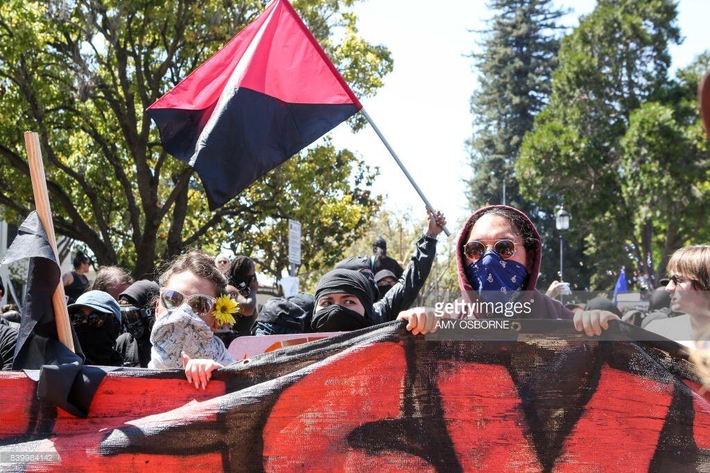 Antifa members and counter protesters gather during a right-wing No-To-Marxism rally on August 27, 2017, at Martin Luther King Jr. Park in Berkeley, California. / AFP PHOTO / Amy Osborne (Photo credit should read AMY OSBORNE/AFP/Getty Images)
