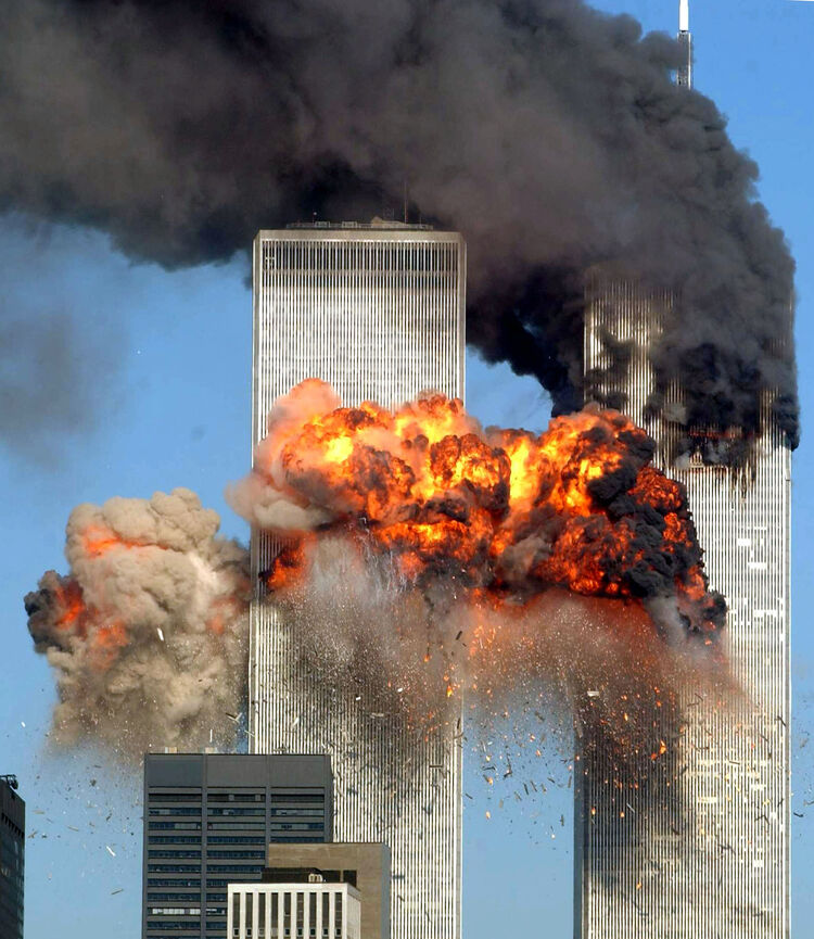 World Trade Center Attacked NEW YORK - SEPTEMBER 11: Hijacked United Airlines Flight 175 from Boston crashes into the south tower of the World Trade Center and explodes at 9:03 a.m. on September 11, 2001 in New York City. The crash of two airliners hijacked by terrorists loyal to al Qaeda leader Osama bin Laden and subsequent collapse of the twin towers killed some 2,800 people. (Photo by Spencer Platt/Getty Images)