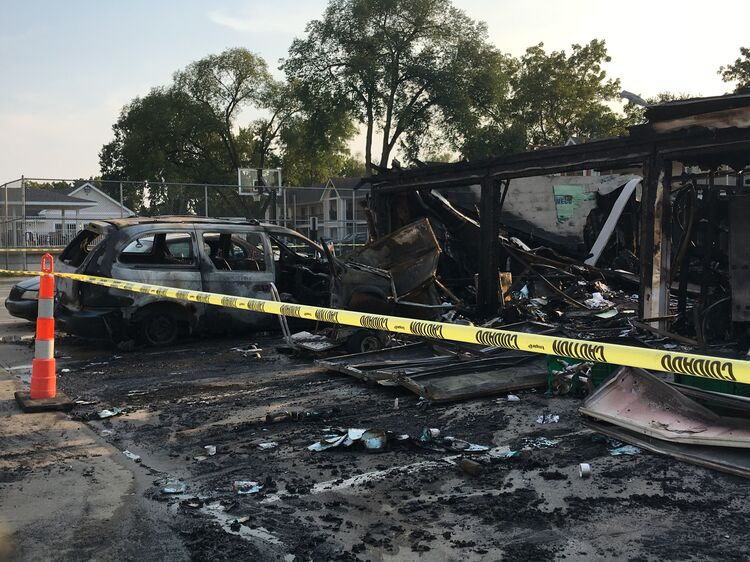 Garages burned at Bennett Grand Woods Apartments in West Des Moines Tuesday. Photos by Wendy Wilde